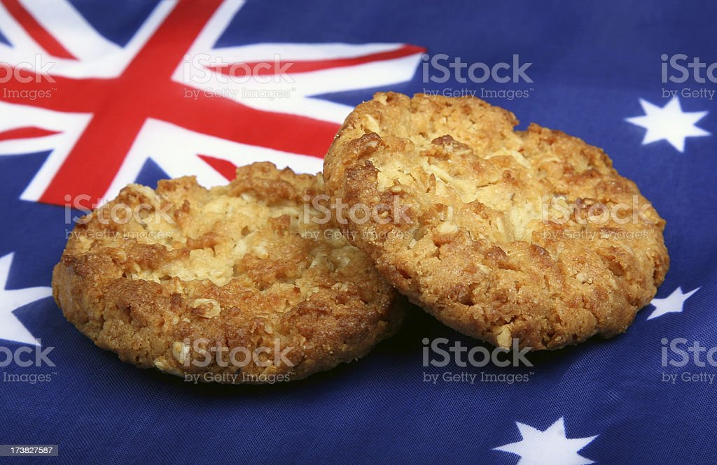 Australian Anzac Biscuits resting on Australian Flag stock photo