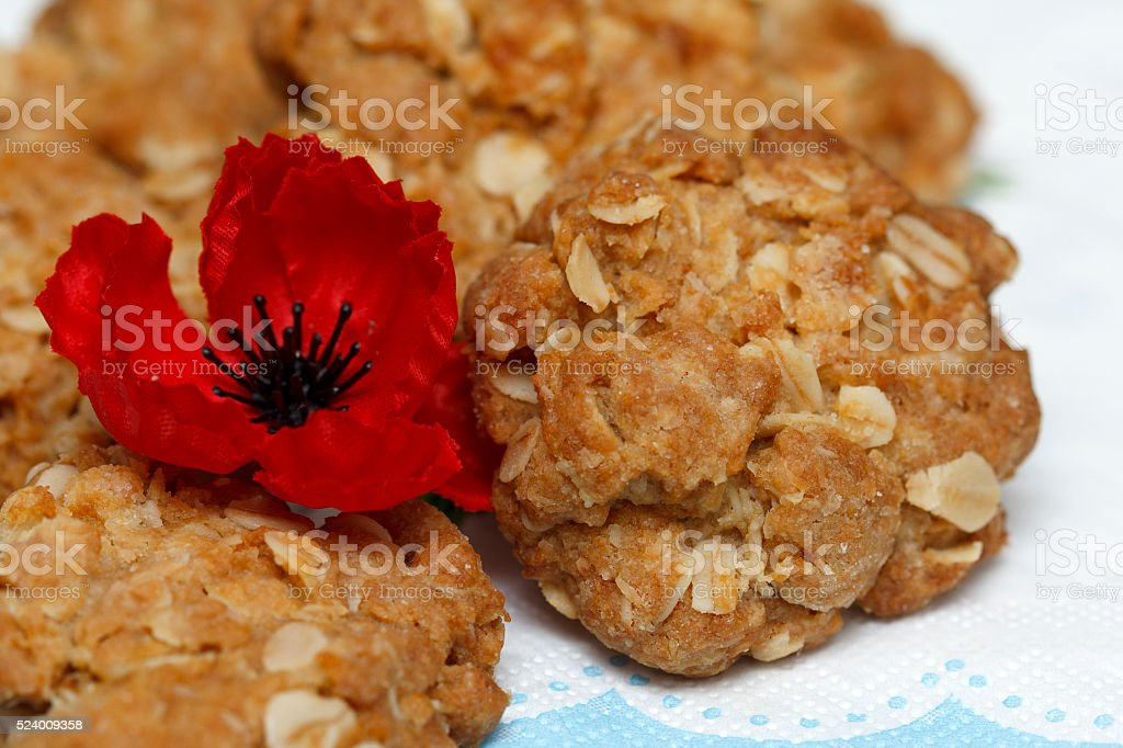 Australian Anzac biscuits with red poppies stock photo