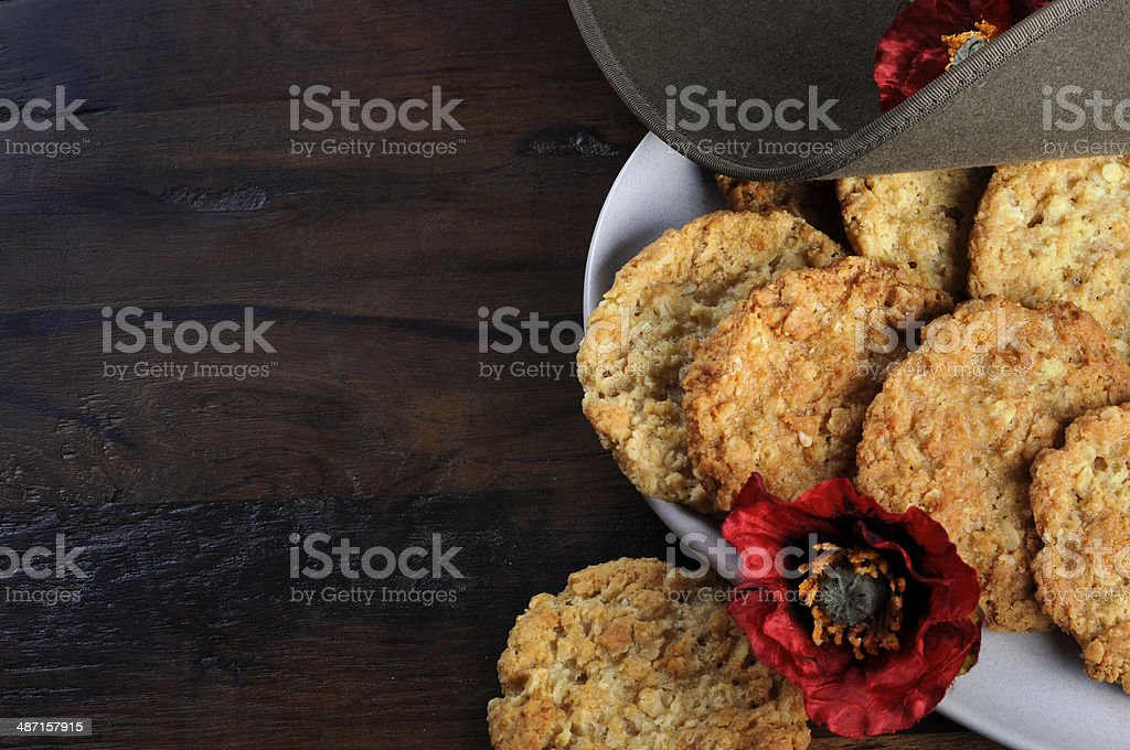 Australian army slouch hat and traditional Anzac biscuits - copyspace stock photo