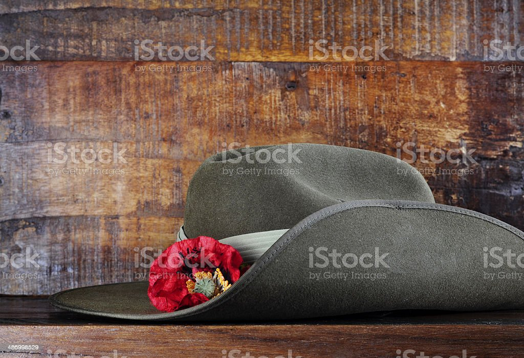 Australian army slouch hat on dark recycled wood stock photo