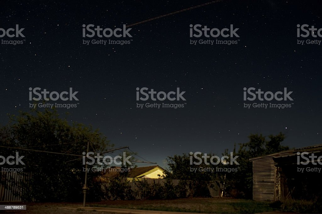 Australian backyard at night stock photo