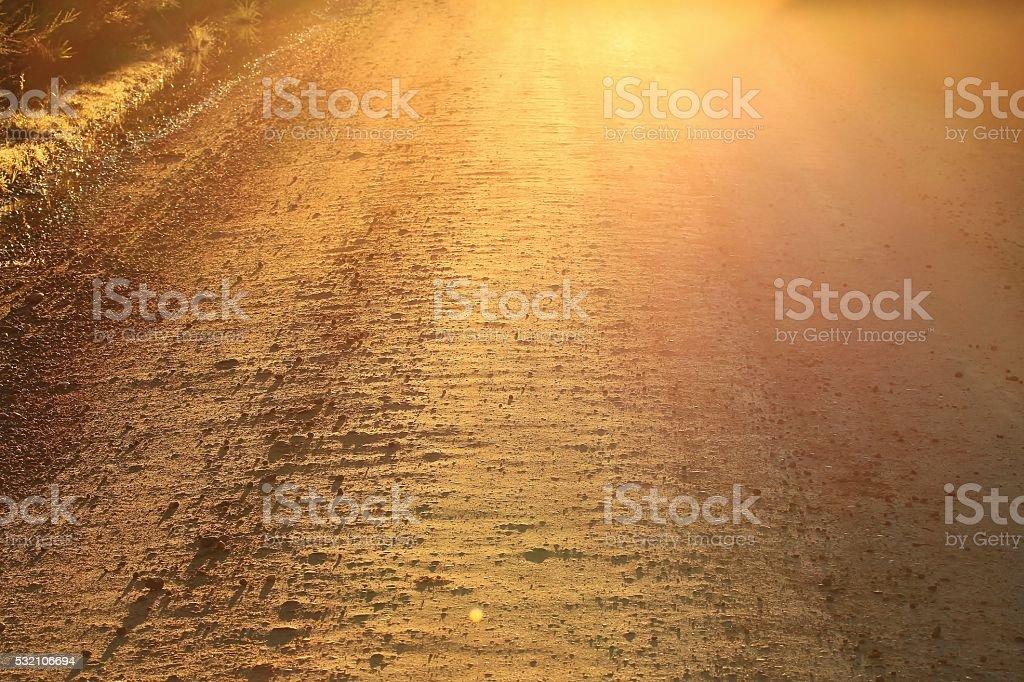 Australian dirt road at sunrise stock photo