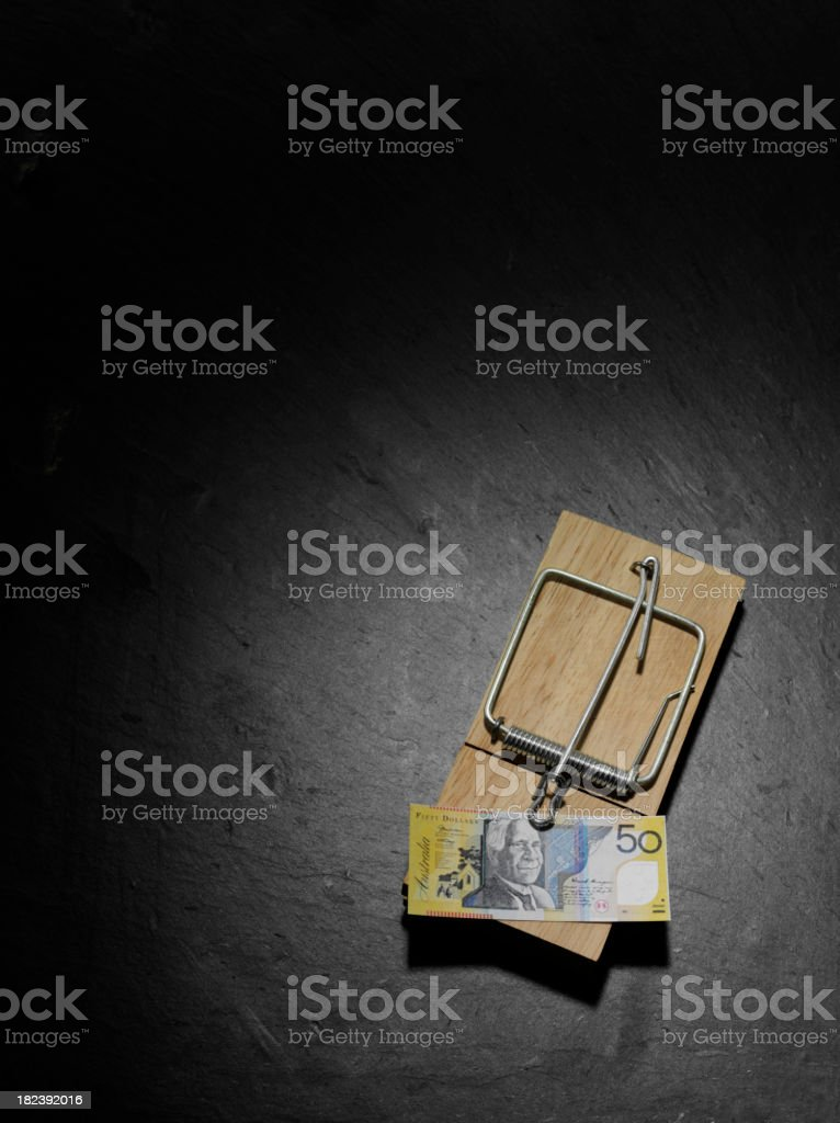 Australian Dollars in a Mousetrap stock photo