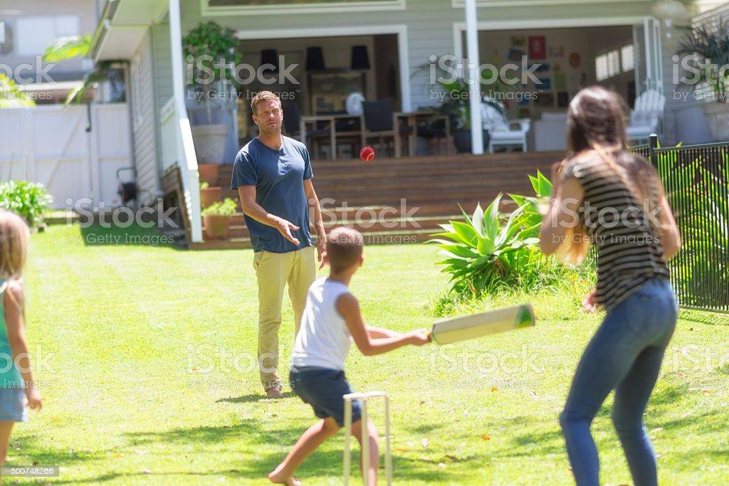 Australian family playing cricket stock photo