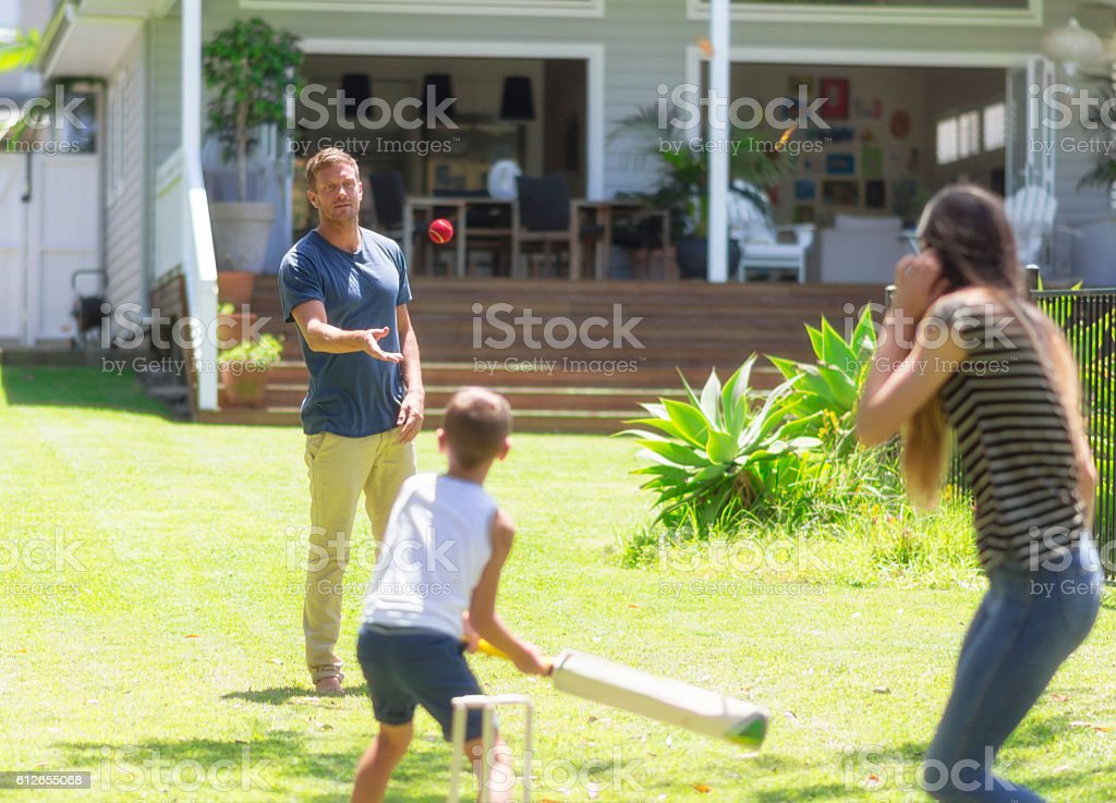 Australian family playing cricket stock photo