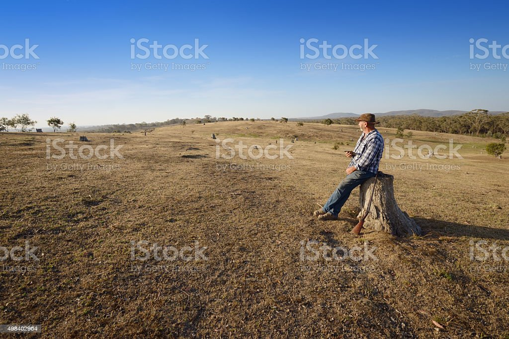 Australian Farmer using Tablet Outdoors stock photo