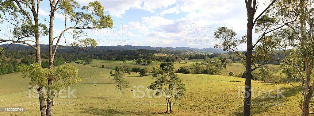 Australian farmland panorama with native trees and hills royalty-free stock photo