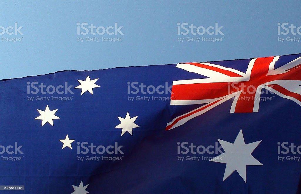 Australian Flag Against Clear Blue Sky stock photo