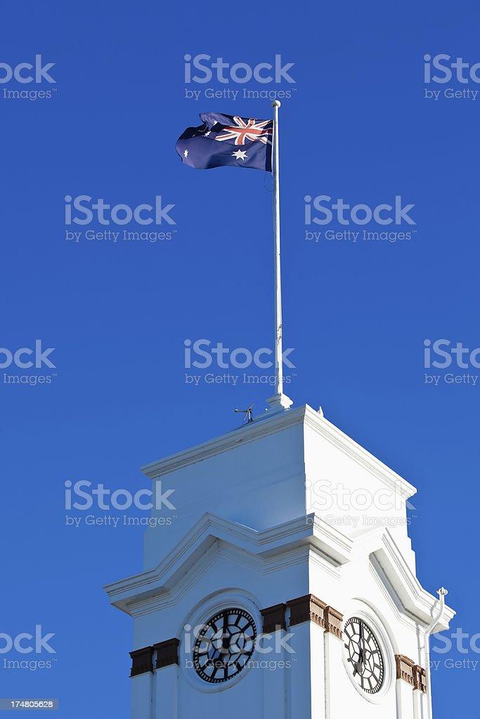 Australian Flag Atop of Clock Tower royalty-free stock photo