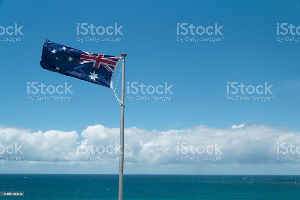 Australian Flag in the ocean stock photo