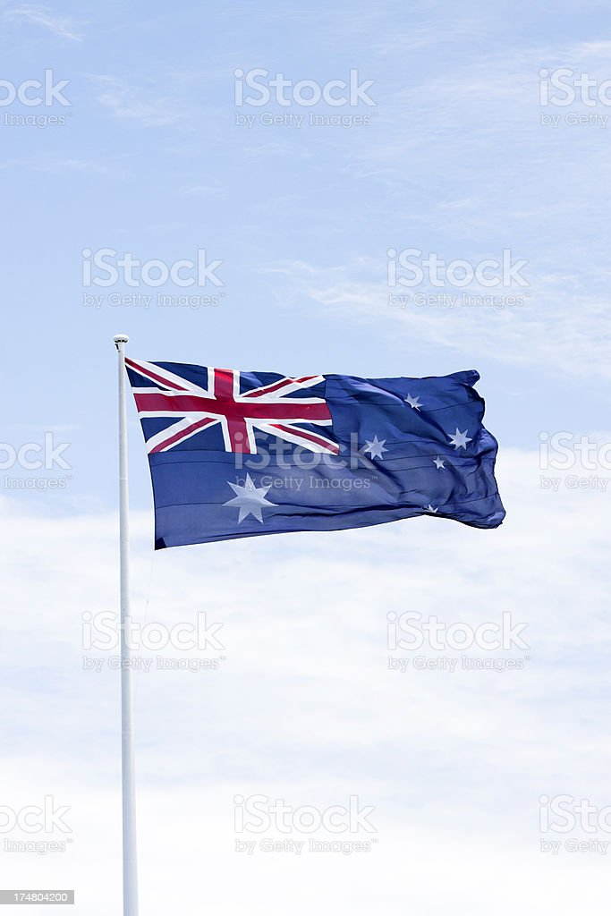 Australian flag in the wind against sky with copy space stock photo