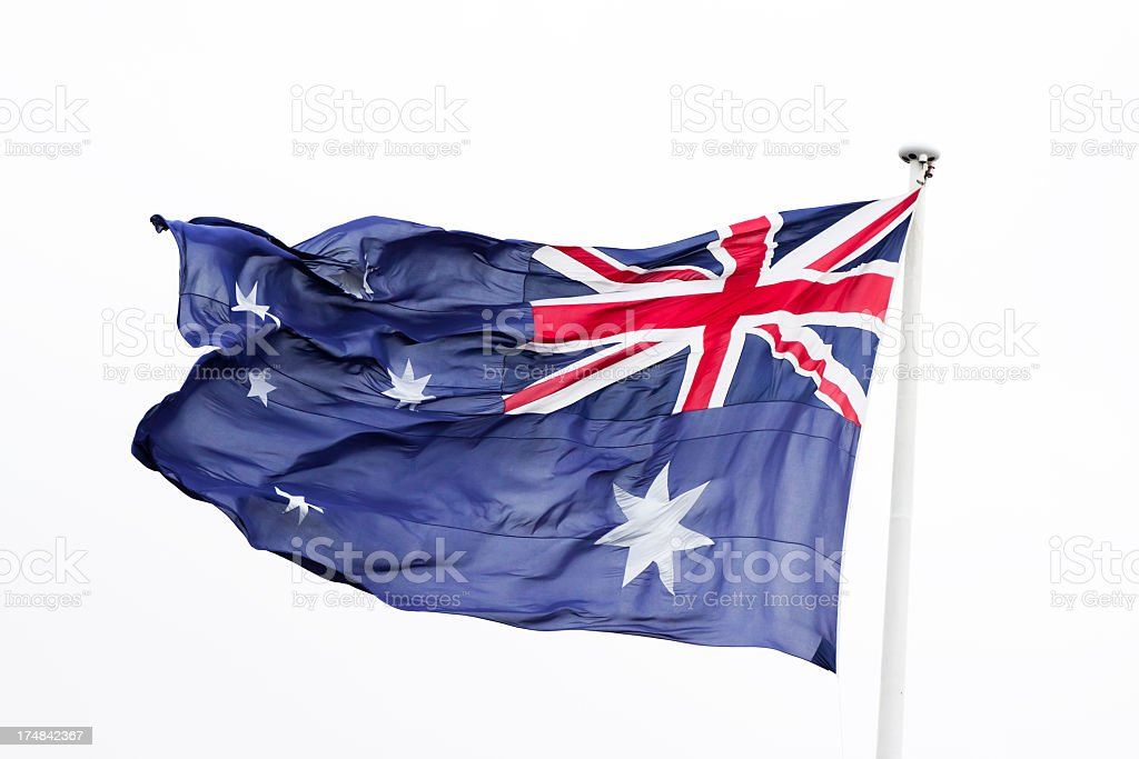 Australian flag in the wind against white background, copy space royalty-free stock photo