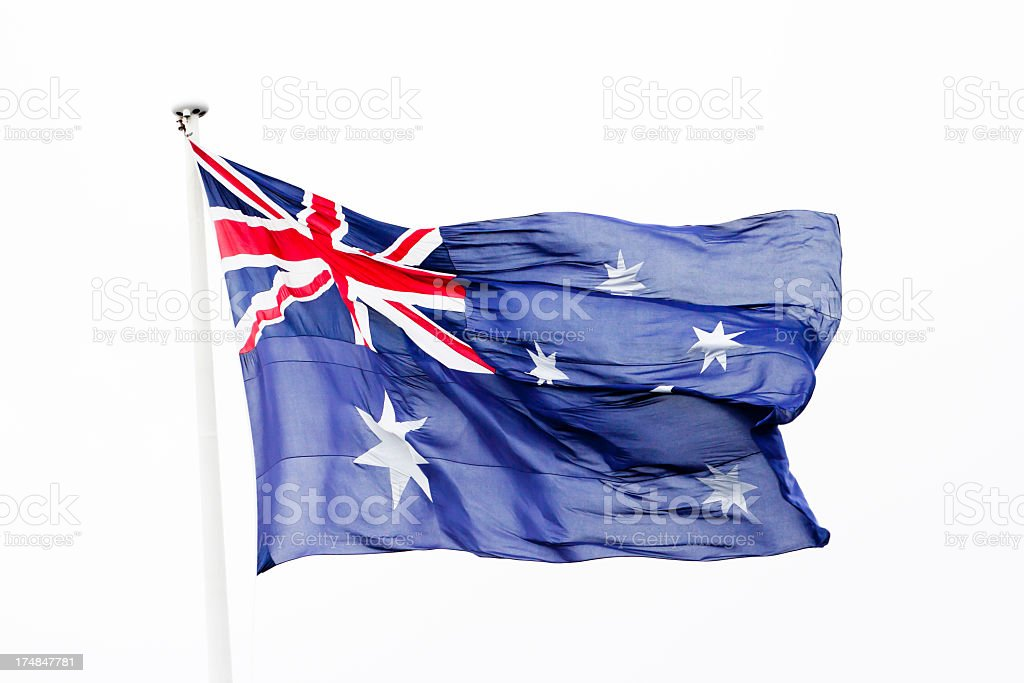 Australian flag in the wind against white background, copy space stock photo