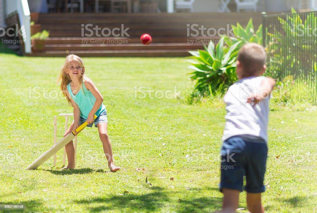Australian kids playing cricket stock photo