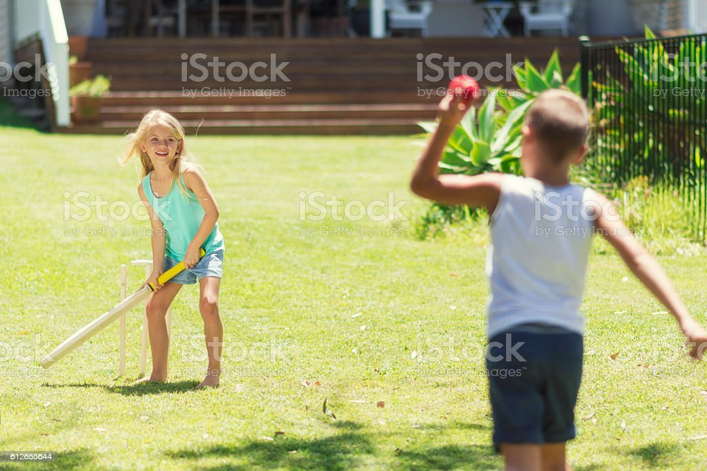 Australian kids playing cricket stock photo