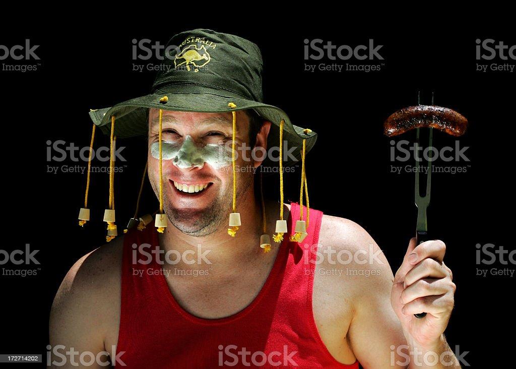 Australian man holding sausage at a BBQ  stock photo