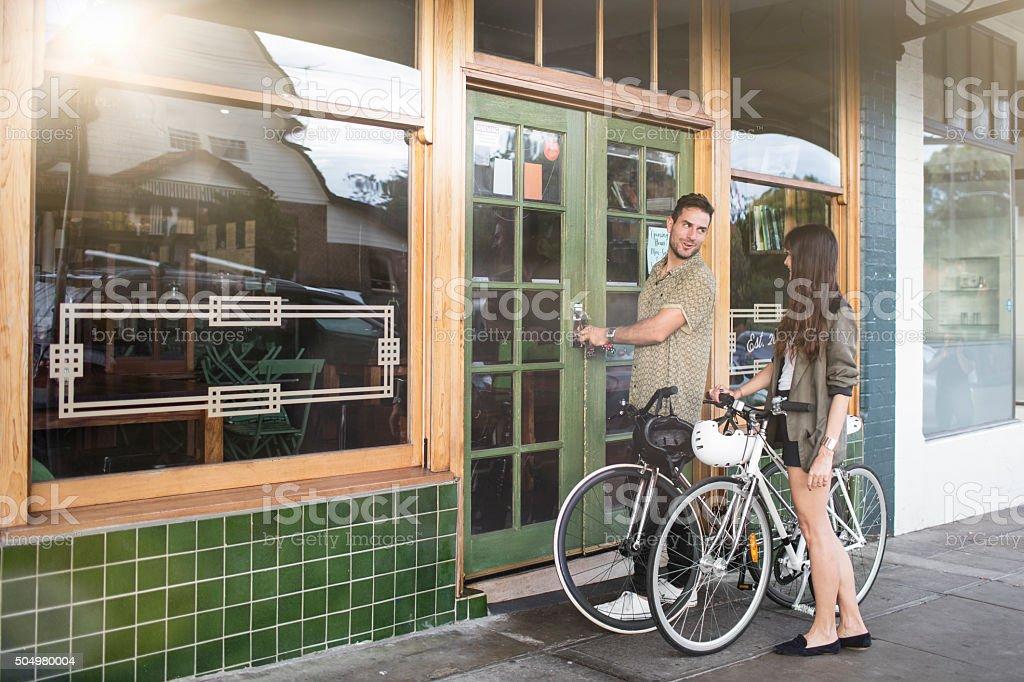 Australian mid adult couple locking their coffee shop business stock photo
