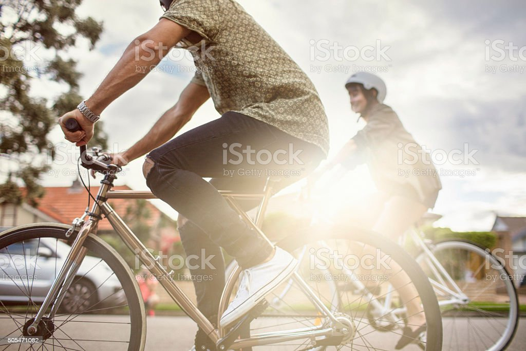 Australian mid adult couple riding bikes back home stock photo