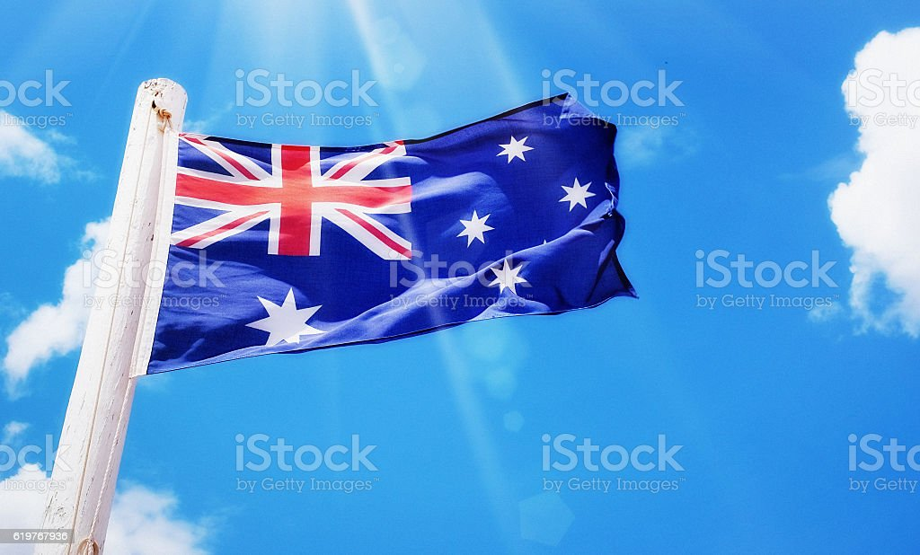 Australian national flag blowing in a breeze stock photo