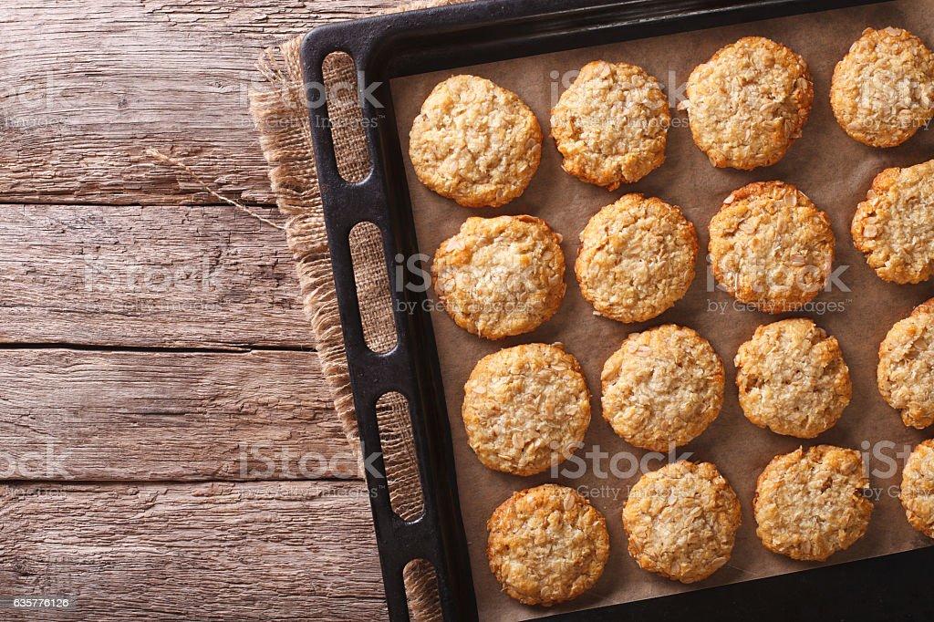 Australian oatmeal cookies on a baking sheet. Horizontal top view stock photo
