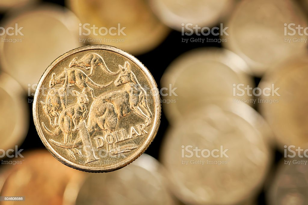 Australian One Dollar Coin over Blurred Golden background stock photo