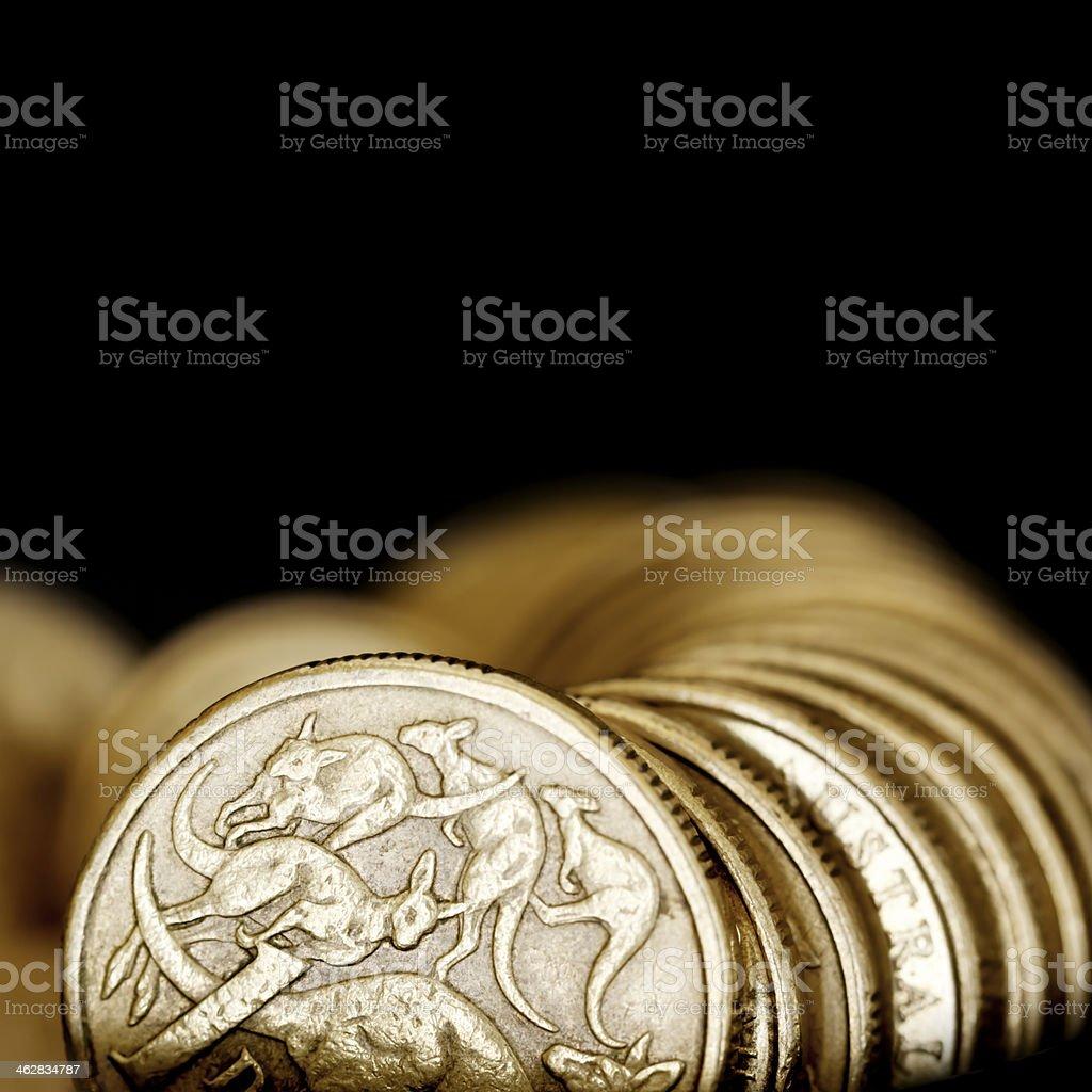 Australian One Dollar Coins over Black stock photo