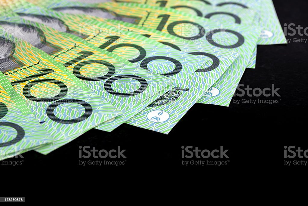 Australian One Hundred Dollar Bills over Black royalty-free stock photo