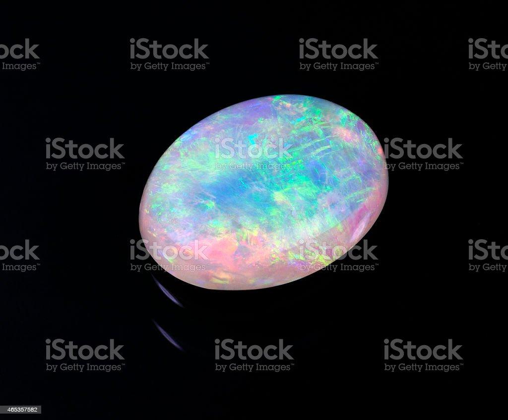 Australian opal isolated on black background stock photo