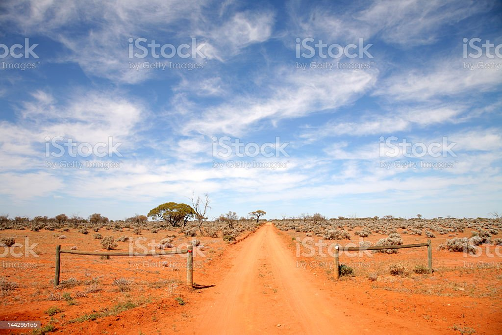 Australian outback road with edge-less sand stock photo