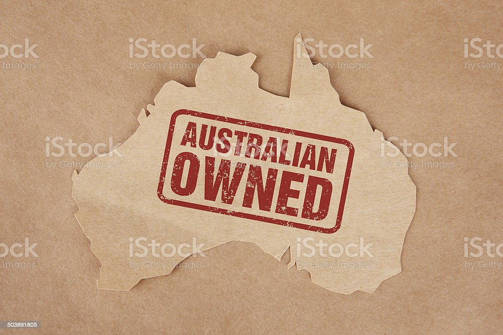 Australian Owned Stamped on Brown Paper Australia with Cardboard Background stock photo