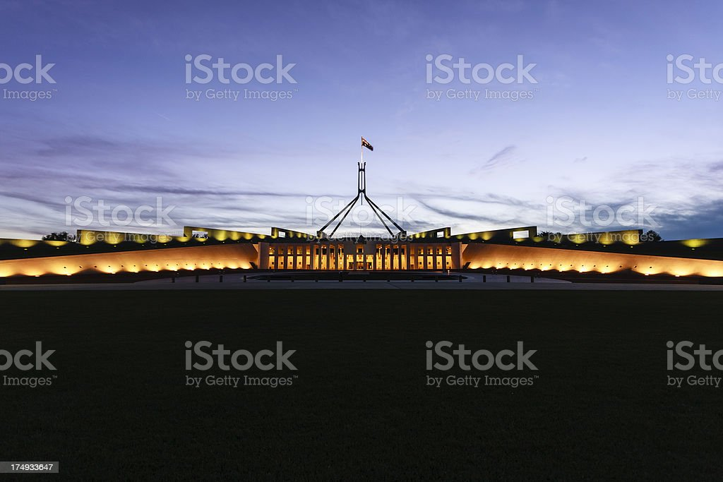 Australian Parliament House illuminated with dark blue sky stock photo
