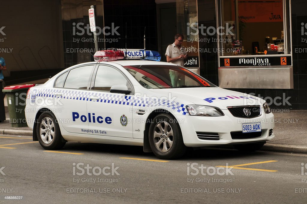 Australian police car parked outside a coffee shop stock photo
