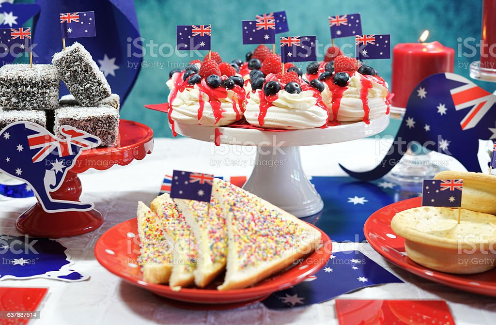 Australian theme party table with flags and iconic food stock photo