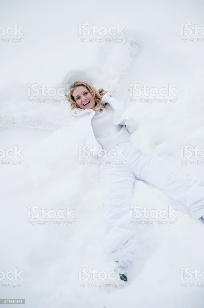 Austria, Altenmarkt, Young woman playing in snow stock photo