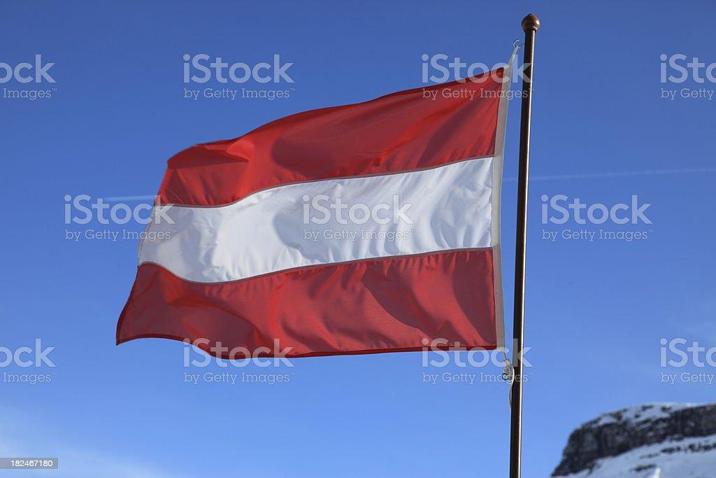 Austria flag on a mountain top royalty-free stock photo