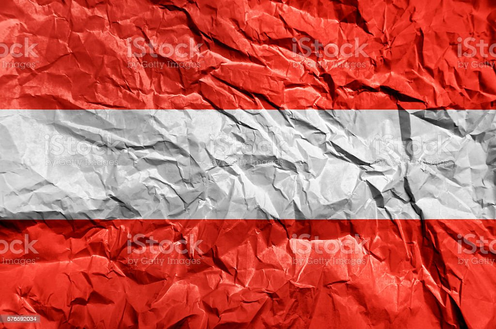 Austria flag painted on crumpled paper background stock photo