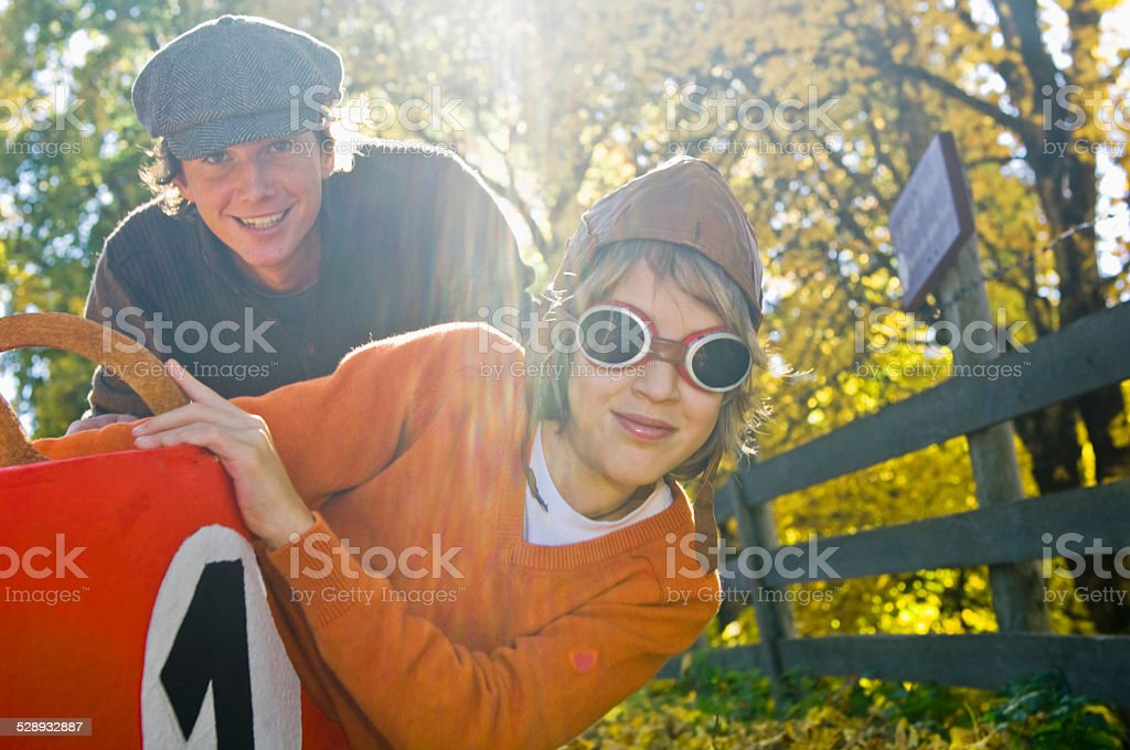 Austria, Salzburger Land, father and son with soapbox car, smiling stock photo