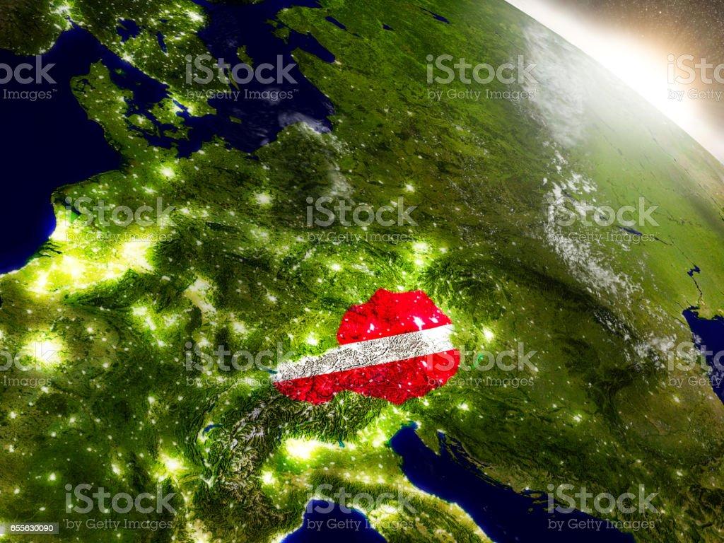 Austria with flag in rising sun stock photo