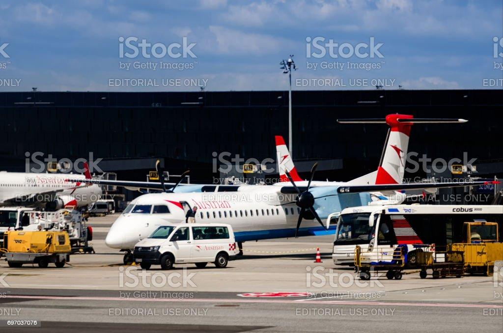 Austrian Airlines little airplane in Wien Flughafen Airport stock photo