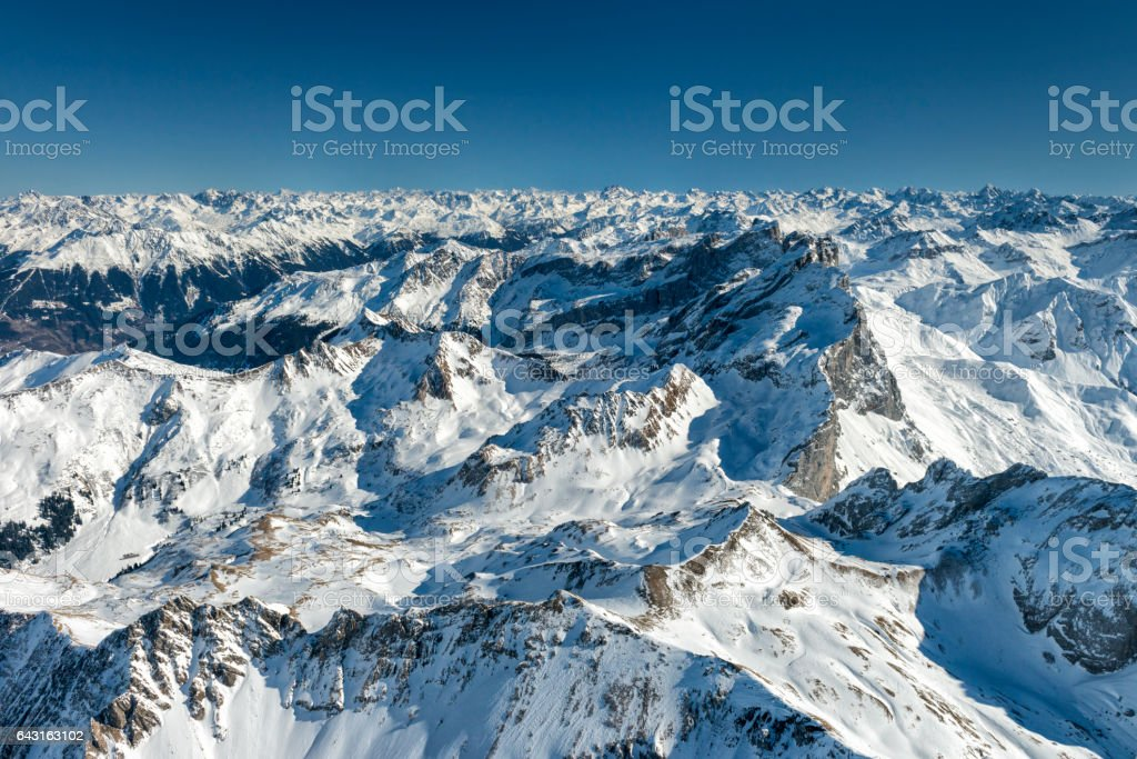 austrian alps in winter seen from plane stock photo