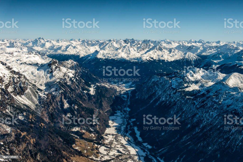 austrian alps in winter seen from plane stock photo