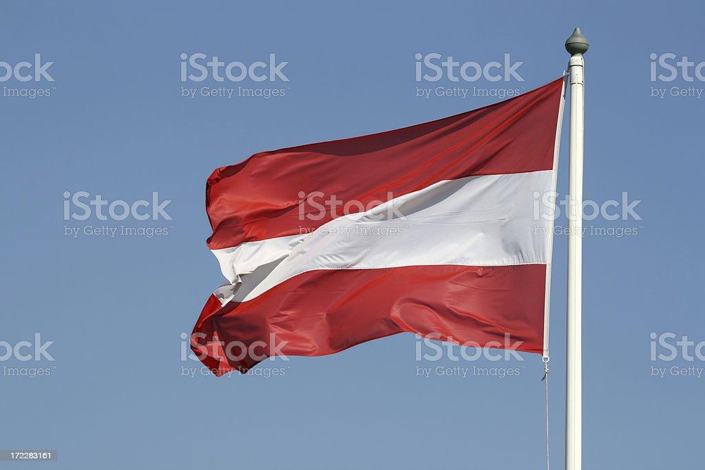 Austrian flag against blue sky, Austria stock photo