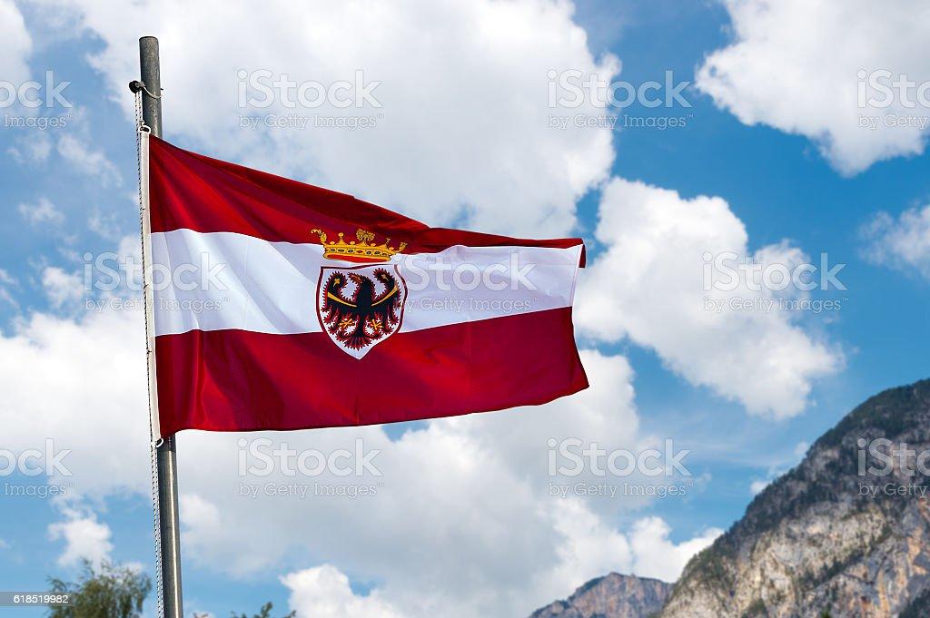 Austrian Flag with Pole on Blue Sky stock photo