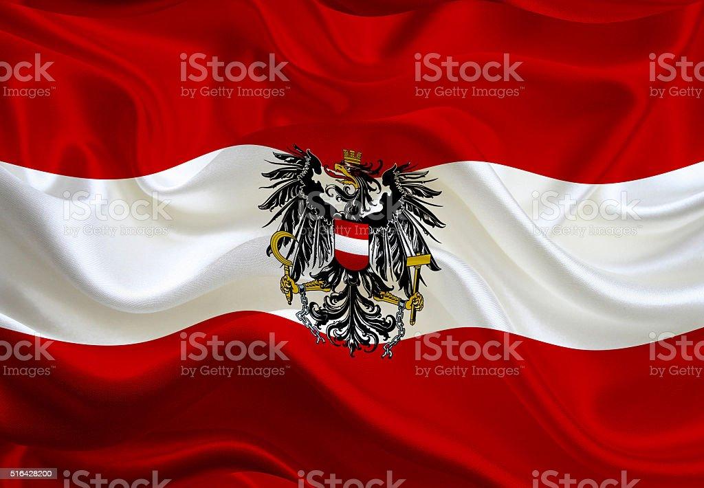 Austrian flag with the emblem stock photo