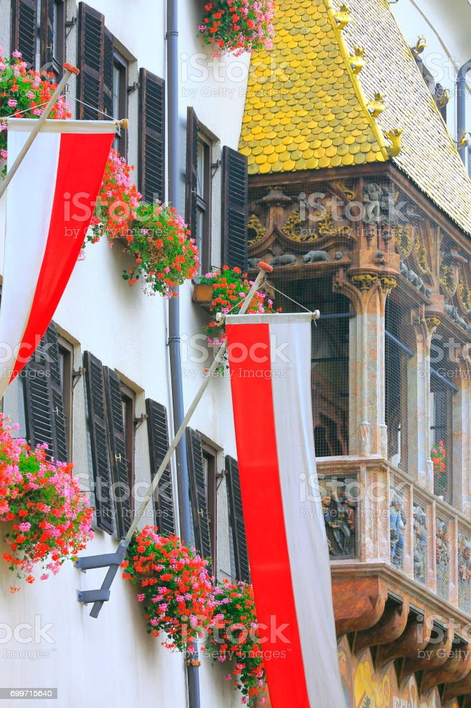 Austrian flags patriotism and Medieval Golden roof of Innsbruck old town square, Cityscape panorama of Tirol capital,  Austria stock photo