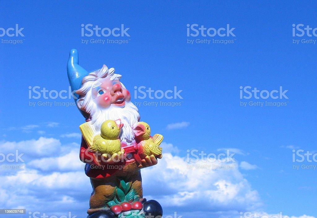 Austrian garden gnome, holding 2 birds stock photo