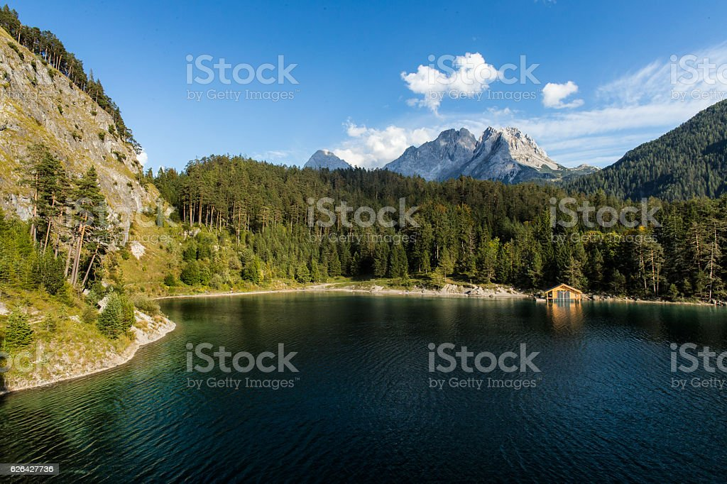 Austrian Mountain Lake with boat hut stock photo