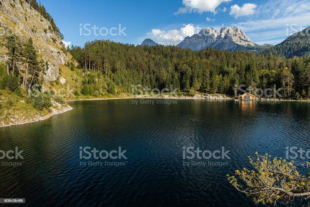 Austrian Mountain Lake with boat hut stock photo