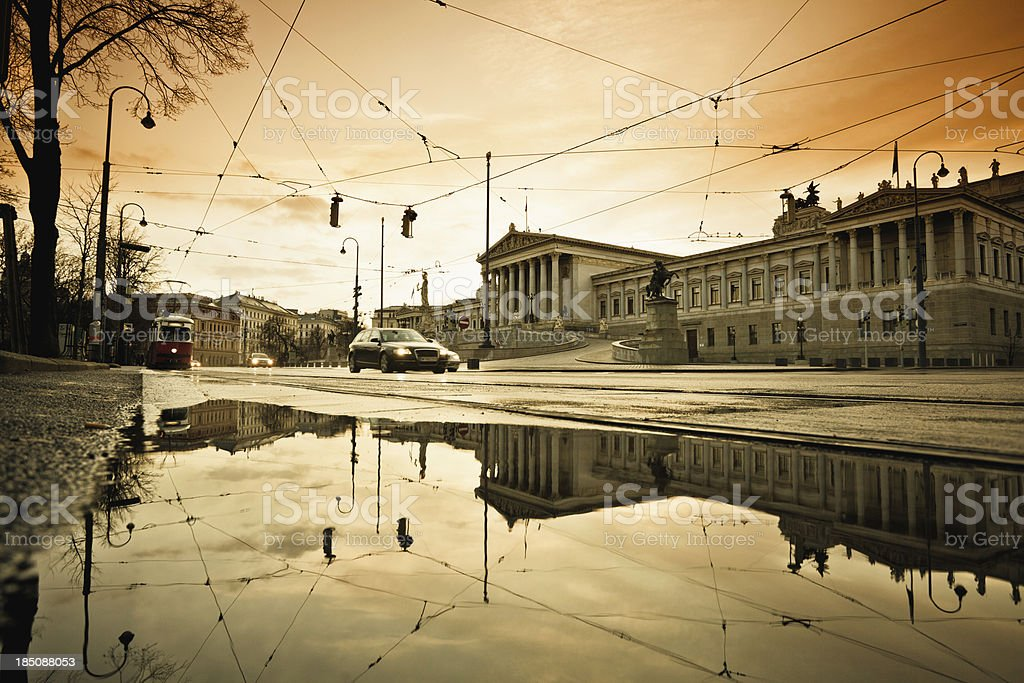 Austrian Parliament in Vienna, Car and Tram Traffic at Sunset royalty-free stock photo