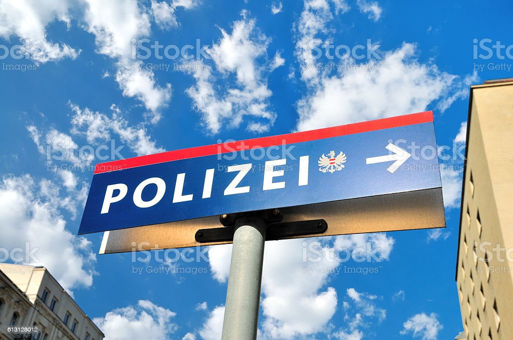 Austrian Police (Polizei) Road Sign against White Fluffy Clouds, Vienna stock photo